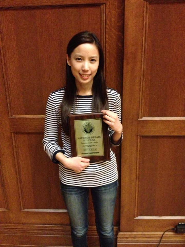 May-Zhee poses with her plaque for being named a CEDA All-American Scholar, Summa Cum Laude.