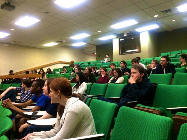 Students and community members wait for the debate to begin.